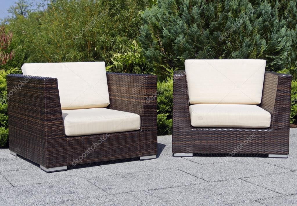 Outdoor furniture rattan armchairs on terrace garden