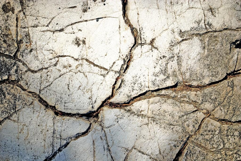 Texture of stone with deep cracks