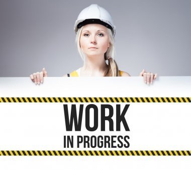 Worker holding work in progress sign placed on information board stock vector