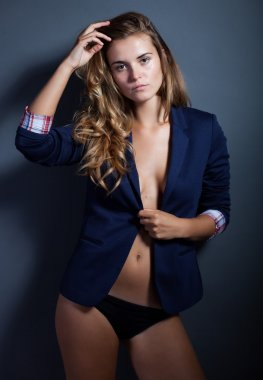 Sexy woman without bra, jacket and panties