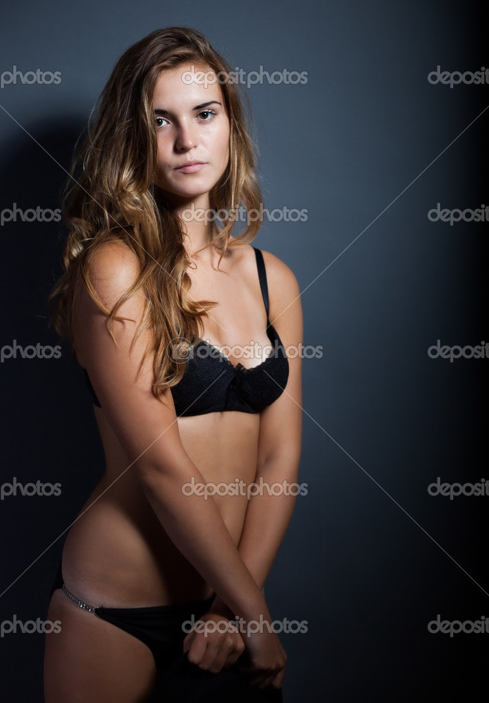 ca969faeea4 Portrait of sexy woman in lingerie on dark background — Stock Photo ...
