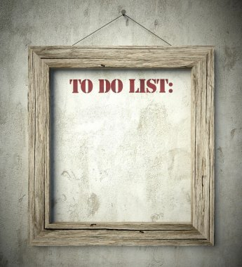 To do list in old wooden frame on wall