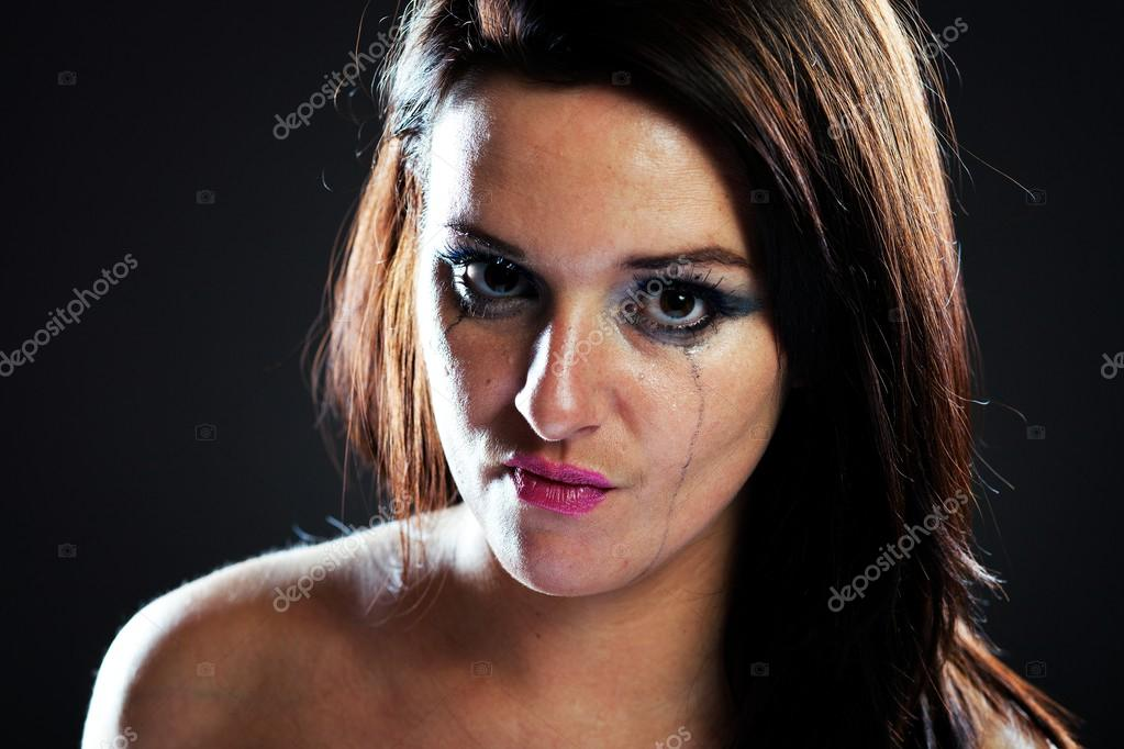 angry and hurt woman crying smeared make up stock photo