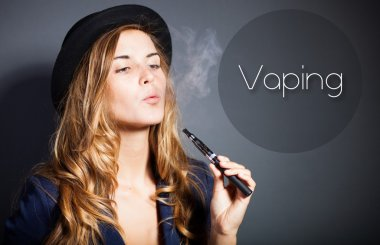 Woman vaping e-cigarette with smoke