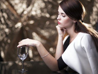 Lonely unhappy woman waiting for date
