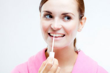 Teeth whitening, woman holding brush