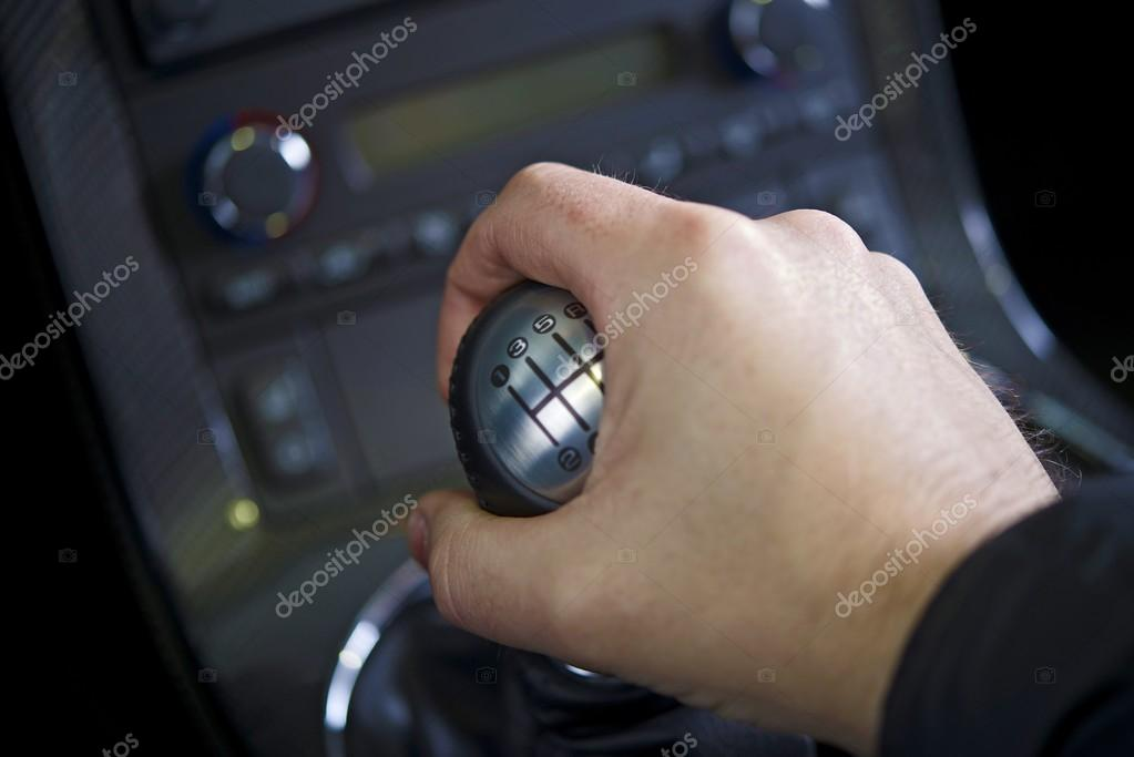 Driving Stick Shift - Hand on the Stick. Manual Car Transmission. Transportation Collection.