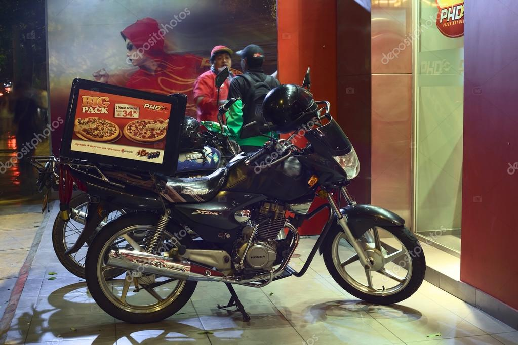 Motorbike In Front Of Pizza Hut Delivery In Lima Peru Stock