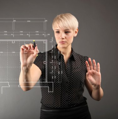 Blueprint design technical concept - girl drawing on screen