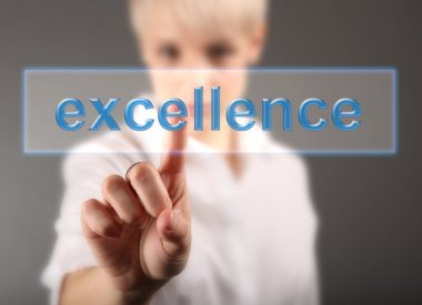 Business woman touching screen with Excellence sign - finance concept