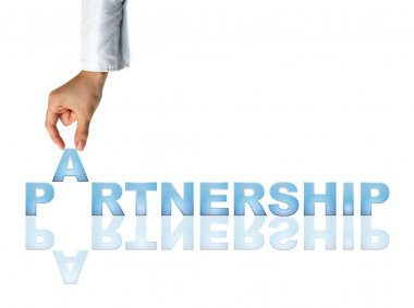 Hand and word Partnership - business concept (isolated on white background)