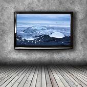 Fényképek Plazma Tv-a falon a szoba
