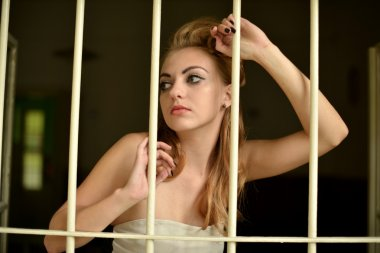 Sexy woman behind bars