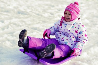 Girl is Sledding, winter fun, snow, family sledding stock vector