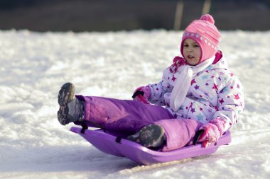 Portrait of happy girl in winter fun, snow, family sledding stock vector