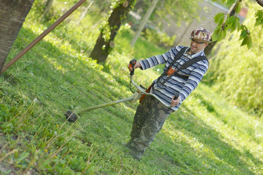 Man cutting grass