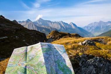 Navigate with map in the mountain