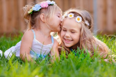 Two happy adorable little  girls sisters on