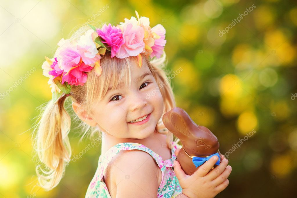 cute easter girl with chocolate bunny
