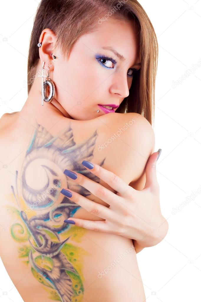 Girl with tattoo and piercings