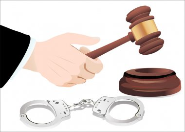 Gavel in hand and handcuffs isolated on white
