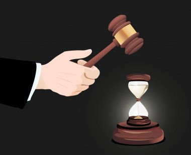 Gavel in hand and clock