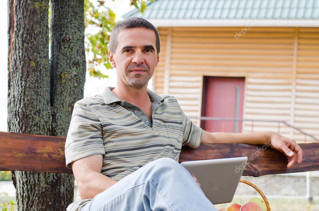 Man relaxing on a garden bench