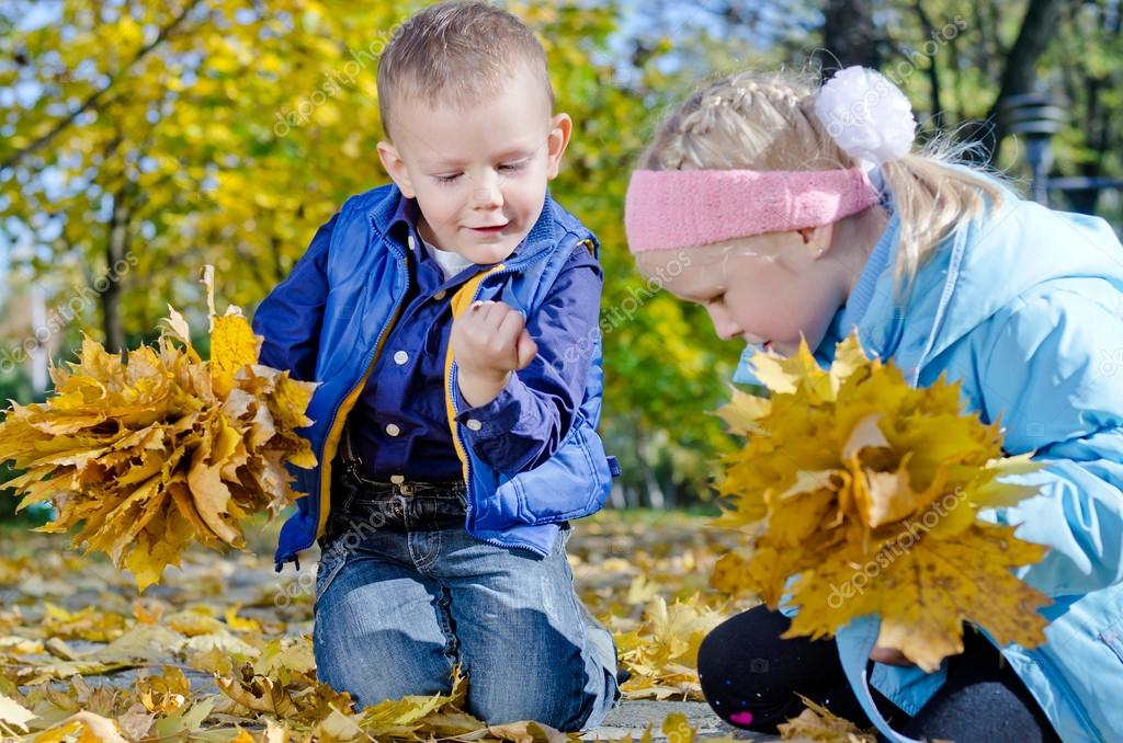 Children collecting fall leaves