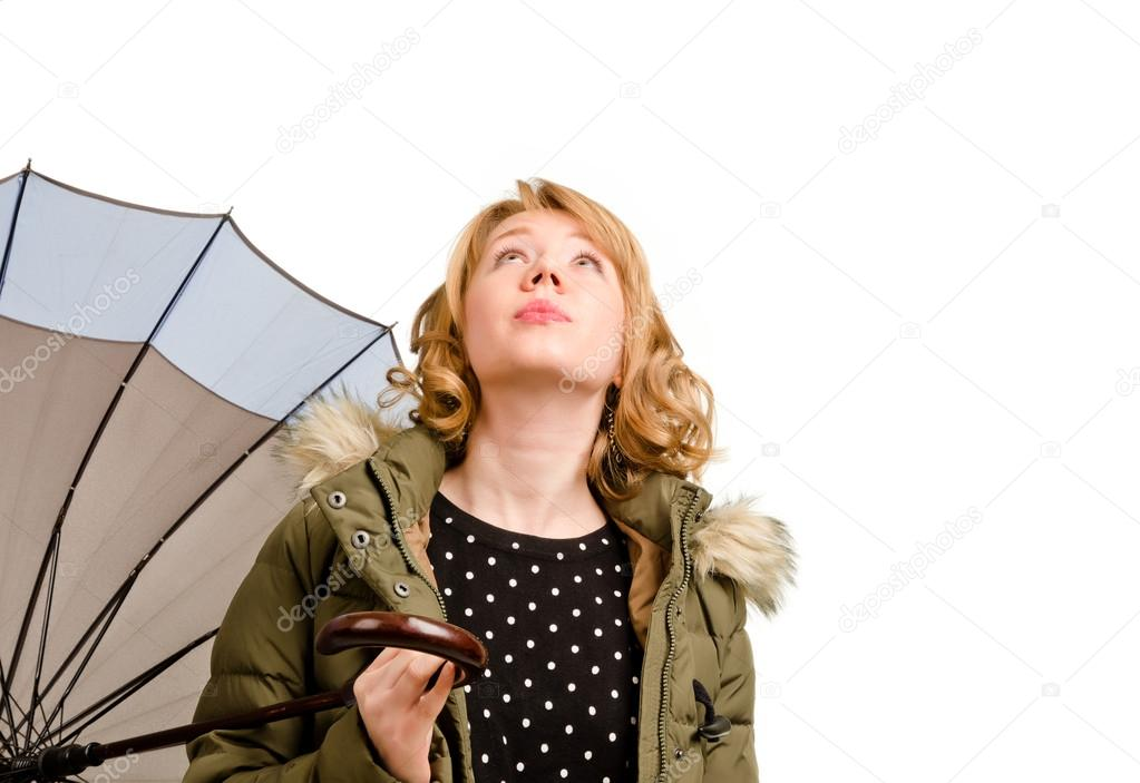 Woman holding umbrella looking at the sky