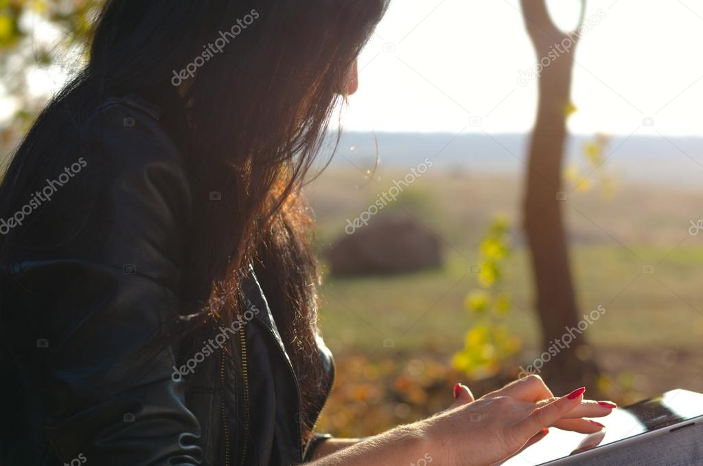 Side view of a woman using a tablet