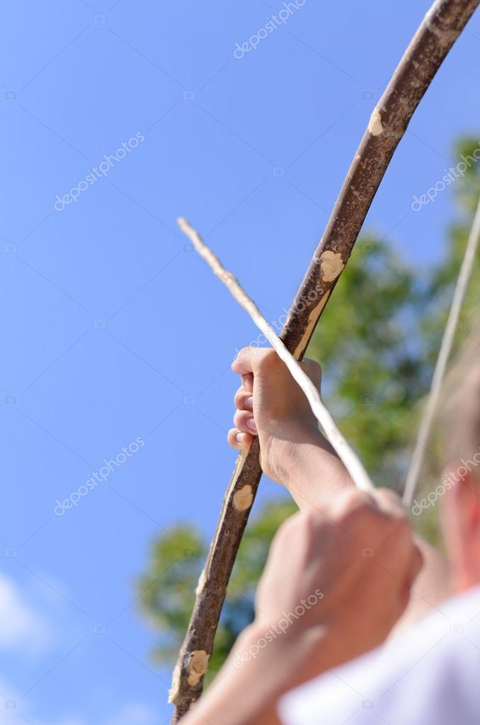 Child taking aim with an arrow