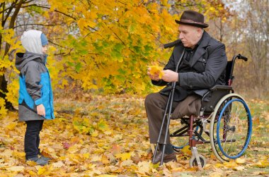 Young boy with his handicapped grandfather