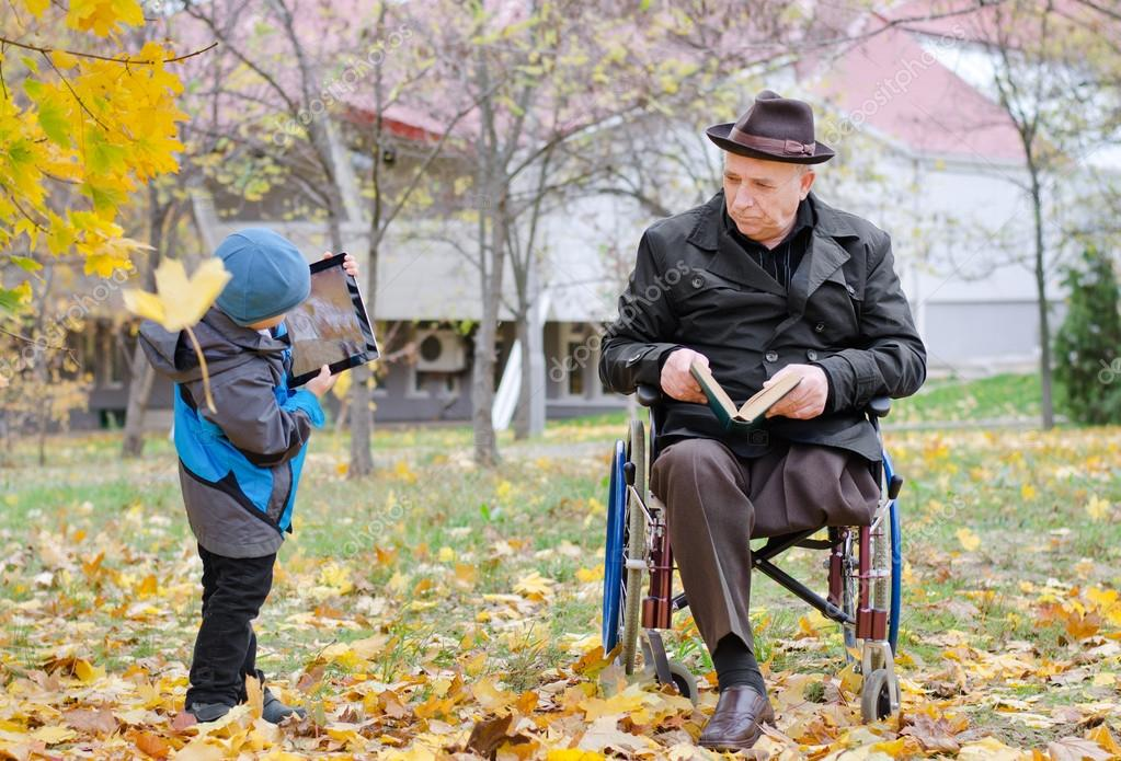 Disabled grandfather watching his grandson