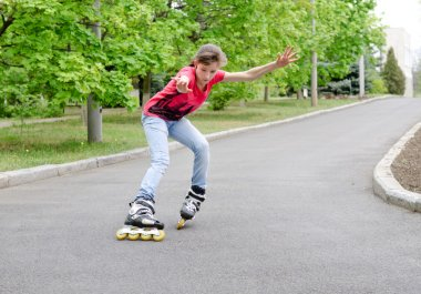 Attractive teenage girl roller skating at speed
