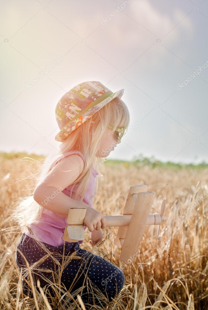 Cute little girl in a colorful hat and sunglasses
