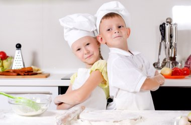 Two cute proud young chefs