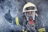 firewoman v obleku požární ochrany