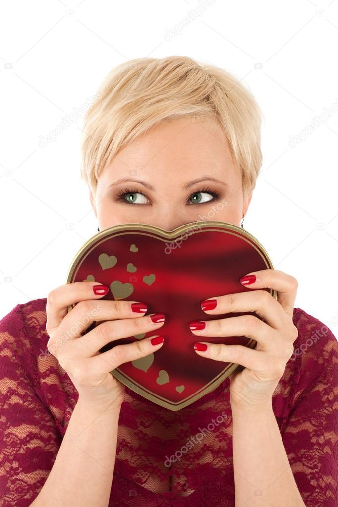Woman with valentine's gift and funny look