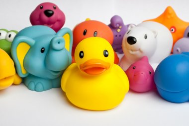 Rubber duck and friends against white background