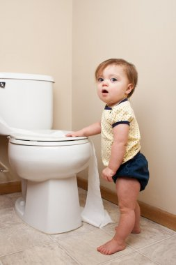 Baby being caught getting into toilet paper
