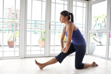 Fitness woman doing her hamstring stretch