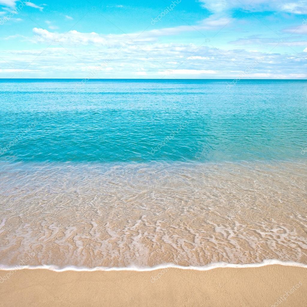 Sandy Beach: Beautiful Sandy Beach With Calm Water Against Blue Skies
