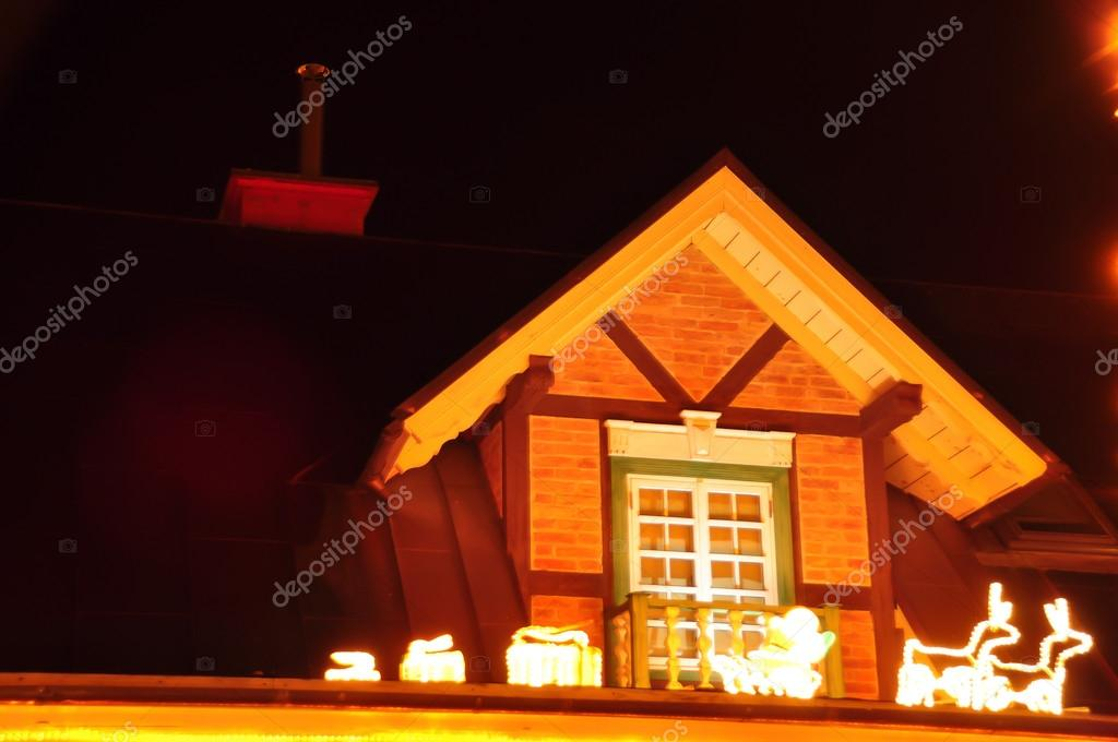 Christmas decorations on the roof of the house– stock image