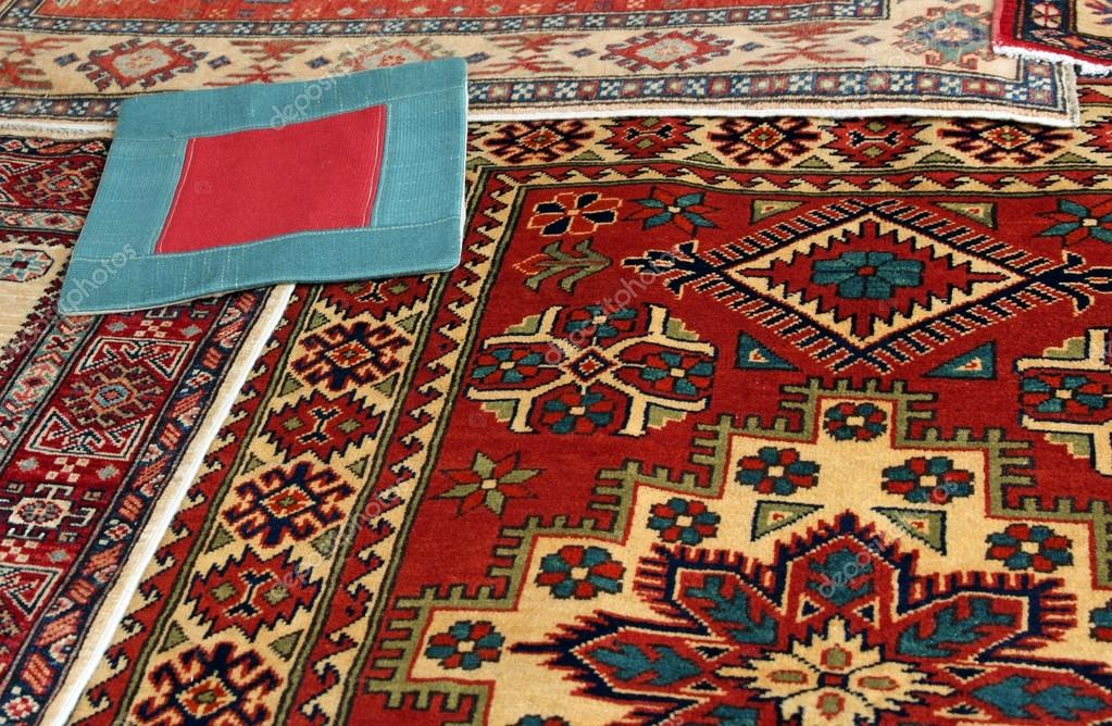 Oriental carpets and a carpet with a red square