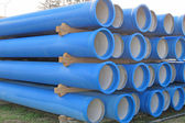Photo piles of concrete pipes for transporting sewerage