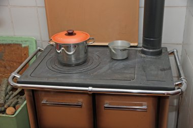 old wood burning stove to a stove with pots over
