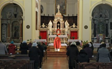 into a church during mass with the Orthodox rite and the priest