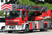 Fotografie truck with ladder of the fire brigade arrives in speed at the pl