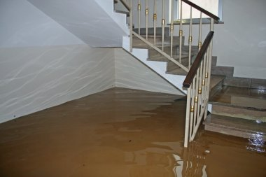 scale of a House fully flooded during the flooding of the river