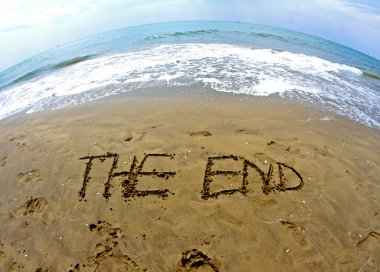 fantastic writing THE END on the sea beach
